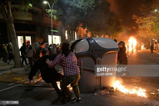 Protesters burn garbage containers during protests in Barcelona on October 15 as Catalonia geared up for more upheaval a day after thousands of...