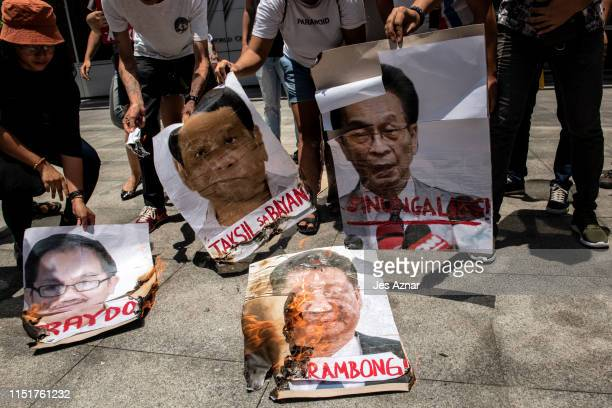 Protesters burn images of Chinese president Xi Jin Ping Philippines president Rodrigo Duterte and local government officials on June 25 2019 in front...