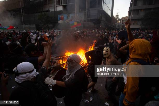 Protesters burn the furnishings of the San Francisco de Borja church of the Chilean Police after setting the church itself on fire during the first...