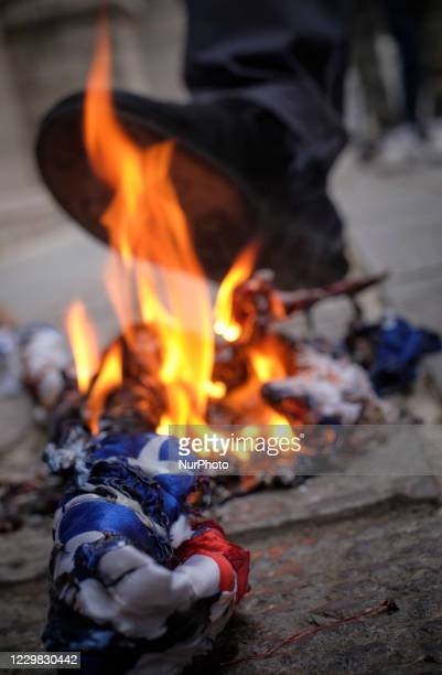 Protesters burn the U.S. Flags during a protest gathering against the assassination of the Iranian Top nuclear scientist and a member of the Irans...