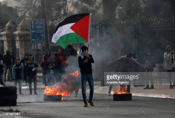 Protesters burn tires and build barricades after Israeli security forces' intervention in a protest against US President Donald Trump's Middle East...