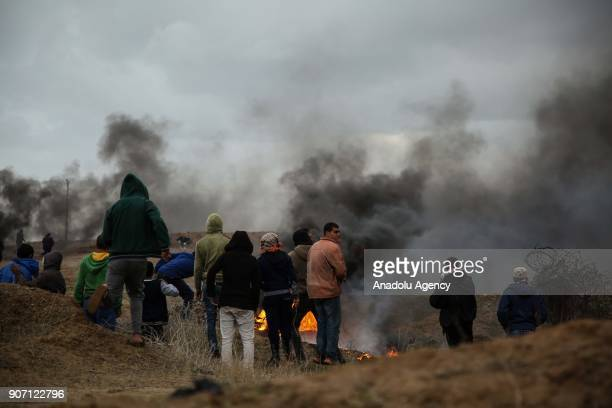 Protesters burn tires in response to Israeli forces' intervention in a protest against US decision to recognize Jerusalem as Israel's capital in Khan...