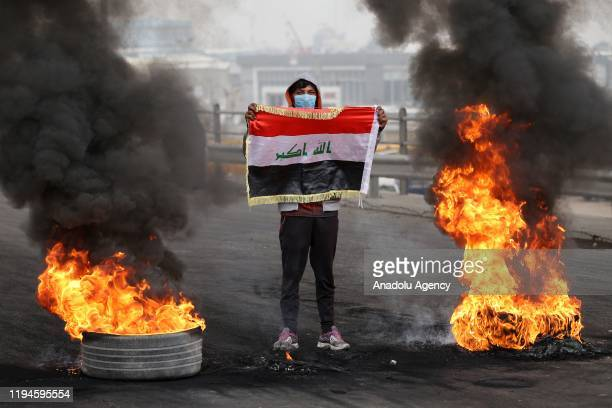 Protesters burn tires to block the road during the anti-government protest in Baghdad, Iraq on January 19, 2020.