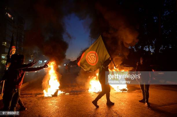 Protesters burn tires used as a road block during a protest to condemn libelous video about Lebanese Parliament Speaker Nabih Berri in Beirut Lebanon...