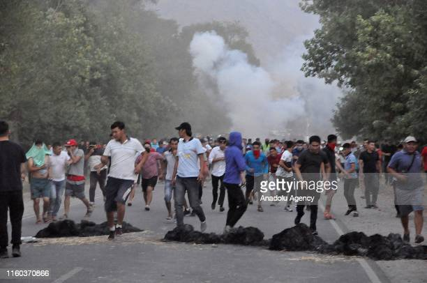 Protesters burn tyres as a barricade during second attempt of clashes between supporters of former Kyrgyzstan President Almazbek Atambayev and...