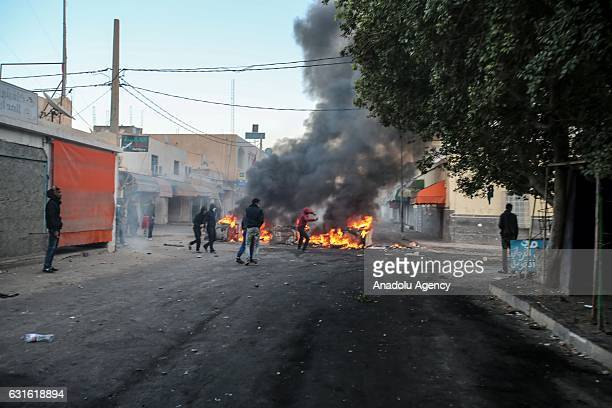 Protesters burn tyres during a demonstration demanding giving social rights to citizens and resolution of the crisis at Ras Jadir border crossing...