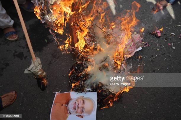 Protesters burning an effigy of Narendra Modi during the demonstration. Delhi Mahila Congress members protest against Prime Minister, Narendra Modis...