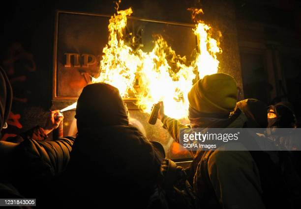 """Protesters burning the metal plate with inscription """"President of Ukraine"""" during a rally close to the Office of the President of Ukraine. Primorsky..."""