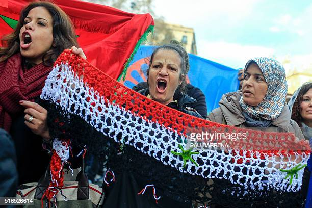 Protesters called by 'Stop Mare Mortum' and Unity against Fascism and Racism platforms hold a Syrian flag as they protest during the European March...