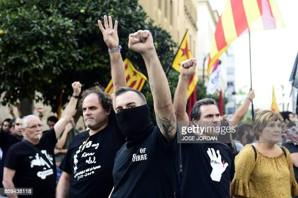 TOPSHOT Protesters calling for Catalan independence gesture opposite rightwing nationalists during counter demonstrations in Valencia on October 9...