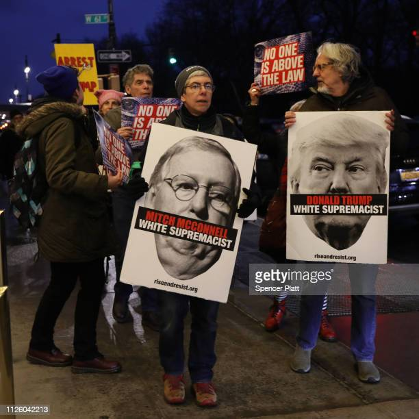 Protesters calling for the impeachment of Donald Trump demonstrate in front of the Trump International Hotel on January 29 2019 in New York City...