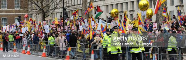 Protesters campaign for Tibet at Downing Street during part of the Olympic torch journey across London on its way to the lighting of the Olympic...