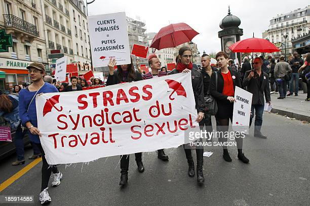 Protesters carry a banner of the Strass sex workers' union during a demonstration against the penalisation of sex workers' clients on October 26 2013...