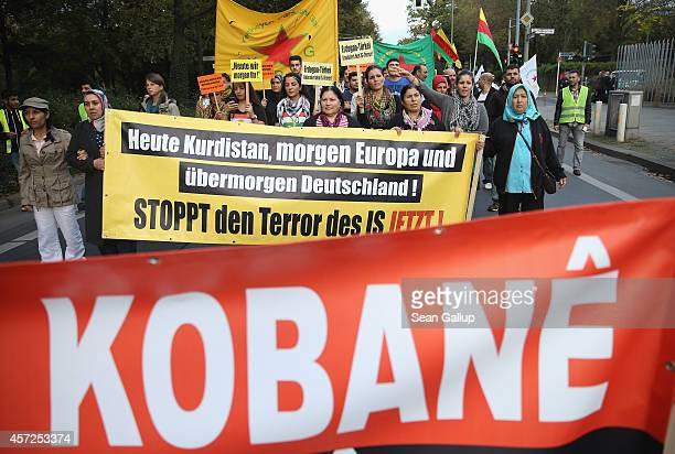 "Protesters carry a banner that reads: ""Today Kurdistan, tomorrow Europe, the day after tomorrow Germany!"", in reference to the Islamic State during a..."