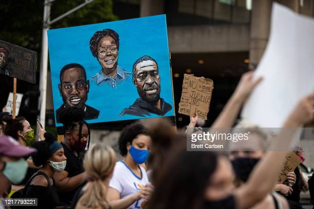 Protesters carry a painting of Ahmaud Arbery Breonna Taylor and George Floyd while marching on June 5 2020 in Louisville Kentucky Protests across the...