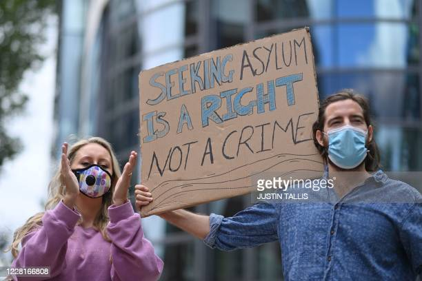 Protesters carry a placard at a demonstration to highlight conditions inside Brook House immigration removal centre, outside the Home Office in...