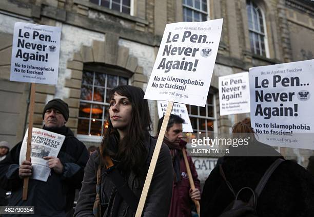 Protesters carry a placard that reads 'Le Pen never again' as they demonstrate outside the Oxford Union in Oxford northwest of London on February 5...