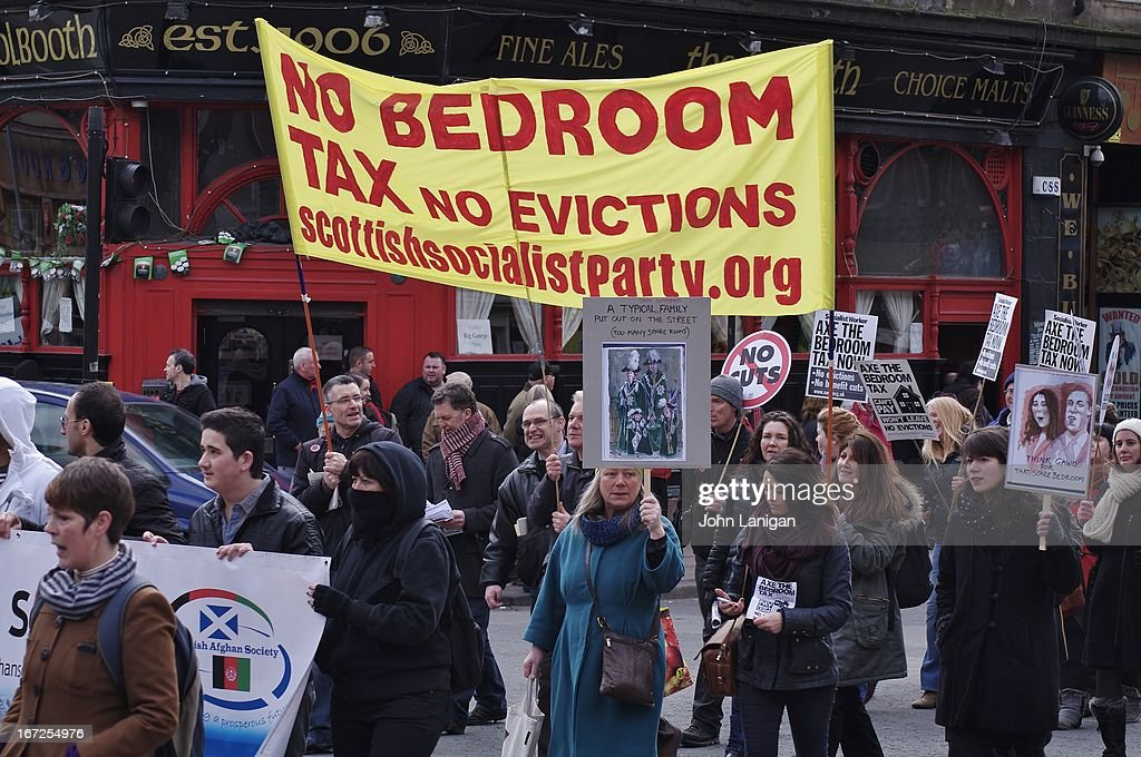 CONTENT] Protesters carry a Scottish Socialist Party banner on the anti bedroom tax protest in Glasgow