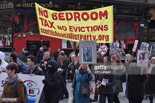 Protesters carry a Scottish Socialist Party banner on the anti bedroom tax protest in Glasgow