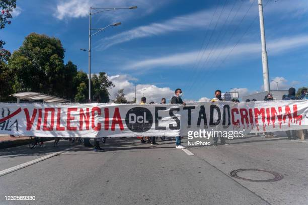 """Protesters carry a sign that says """"No to the violence of the criminal state"""", in the protest against the tax reform proposed by the..."""