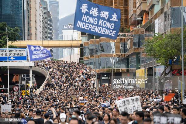 Protesters carry aa Hong Kong independence flag during the anti government march Hundreds of thousands of anti government protesters marched and...