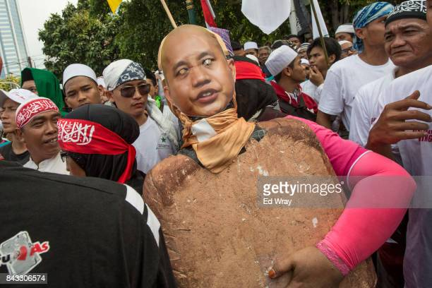 Protesters carry an effigy of Myanmar monk Wirathu as thousands of members of various Indonesian muslim groups demonstrate in support of Myanmar's...
