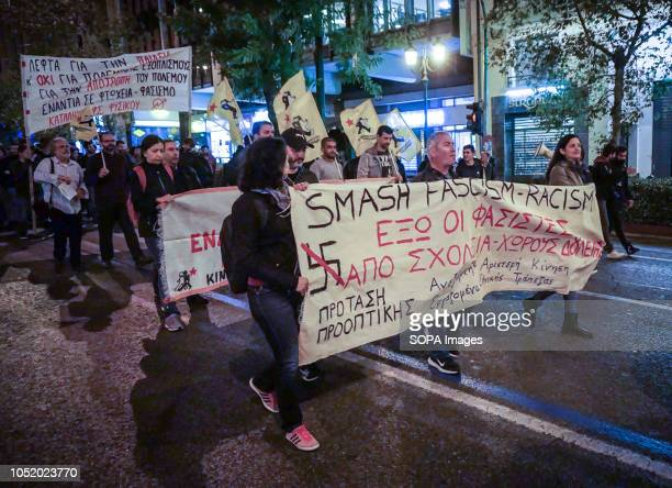 Protesters carry banners during an antiwar rally in Athens Around one hundred protesters took to the street of Athens to condemn nations that...