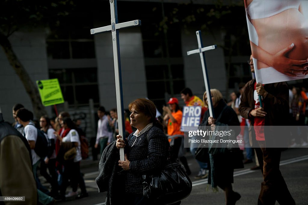 Protesters carry crosses during a pro-life rally against abortion under the slogan 'Every life matters' on November 22, 2014 in Madrid, Spain. Thousands of people from around Spain gathered today in Madrid to protest against abortion and show their disagreement with the Popular Party. The Spanish Government took down a draft-law to cut women's right to decide about abortion due to social unpopularity which also led into the resignation of former Justice Minister Alberto Ruiz Gallardon.