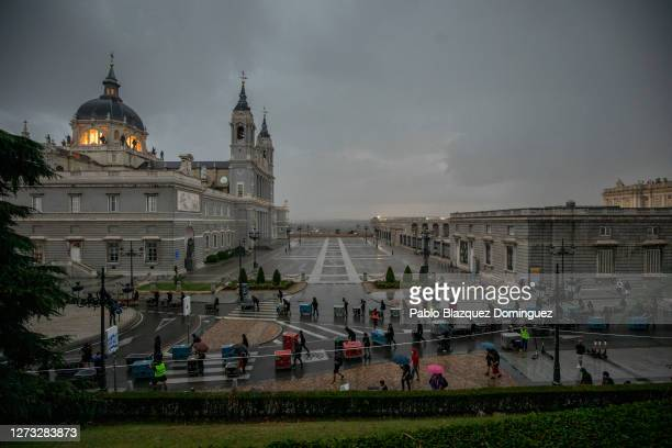 Protesters carry flight cases as they keep social distance during a demonstration next the Royal Palace and the Almudena Cathedral on September 17,...
