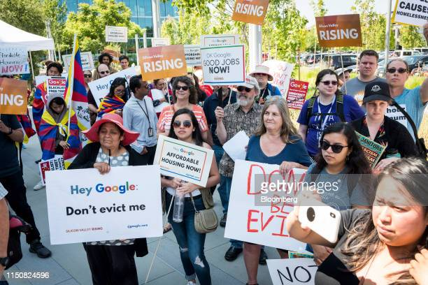 Protesters carry signs while demonstrating outside the Alphabet Inc annual shareholders meeting in Sunnyvale California US on Wednesday June 19 2019...