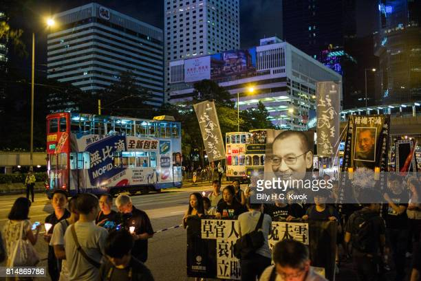 Protesters carrying candles take part in a march to mourn the death of Nobel laureate Liu Xiaobo on July 15 2017 in Hong Kong Hong Kong The body of...