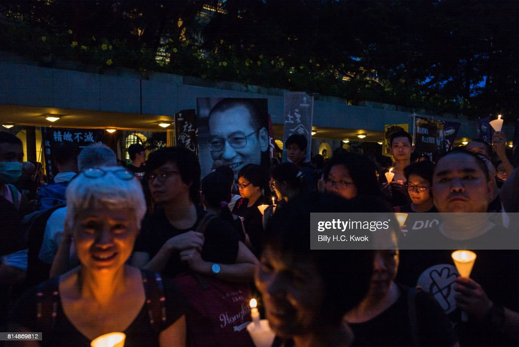 Protesters carrying candles take part in a march to mourn the death of Nobel laureate Liu Xiaobo on July 15, 2017 in Hong Kong, Hong Kong. The body of China's most famous political prisoner, Liu Xiaobo, was cremated under government watch on Saturday in China's Shenyang city with only his widow and a few other mourners to bid farewell. Family members of Liu Xiaobo scattered the ashes of the Nobel Peace Prize-winning Chinese dissident into the sea hours after his cremation during a simple ceremony, ensuring there would be no grave on land, according to reports, as Beijing faces international criticism for not letting the Nobel laureate travel abroad as he had wished.