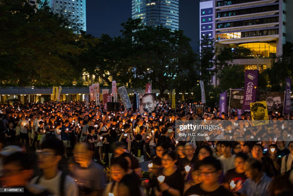 Protesters carrying candles take part in a march to mourn the death of Nobel laureate Liu Xiaobo on July 15, 2017 in Hong Kong, Hong Kong.The body of China's most famous political prisoner, Liu Xiaobo, was cremated under government watch on Saturday in China's Shenyang city with only his widow and a few other mourners to bid farewell. Family members of Liu Xiaobo scattered the ashes of the Nobel Peace Prize-winning Chinese dissident into the sea hours after his cremation during a simple ceremony, ensuring there would be no grave on land, according to reports, as Beijing faces international criticism for not letting the Nobel laureate travel abroad as he had wished.