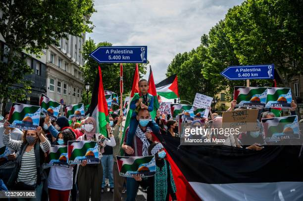 Protesters carrying Palestinian flags and placards during a demonstration against the last attacks by Israel to Palestinian people and coinciding...