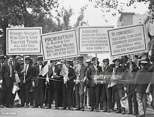 Protesters carrying signs about the negative effects of prohibition on international trade returning soldiers and morals