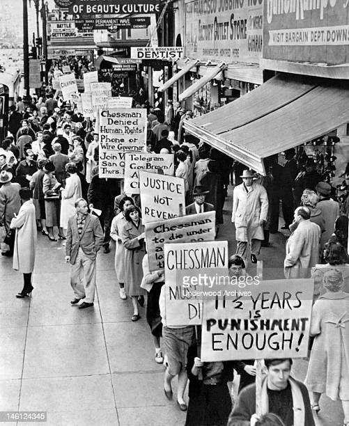 Protesters carrying signs on Market Street asking that convicted robber and rapist Caryl Chessman 'The Red Light Bandit' not be executed for his...