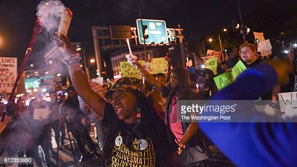 Protesters celebrate as they shut down the intersection of New York Ave and 3rd streets following a candlelight vigil and rally for Terrence Sterling...