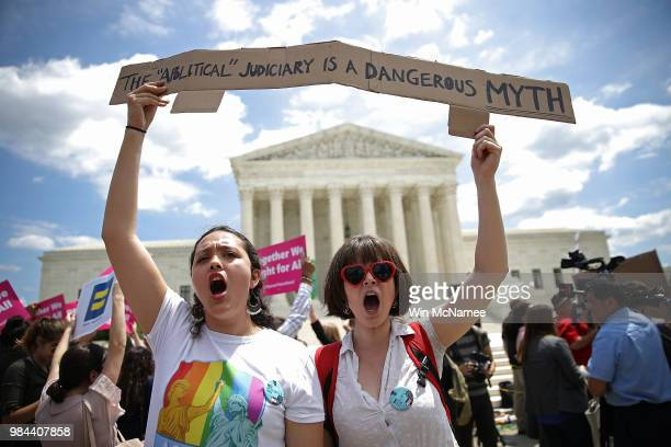 Protesters Celina ScottBuechler and Lisset Pino demonstrate against US President Trump's travel ban as protesters gather outside the US Supreme Court...