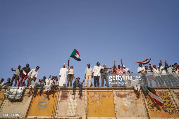Protesters chant above the crowds from the railroad track on May 03, 2019 in Khartoum, Sudan. Thousands of demonstrators continued their mass sit-in...