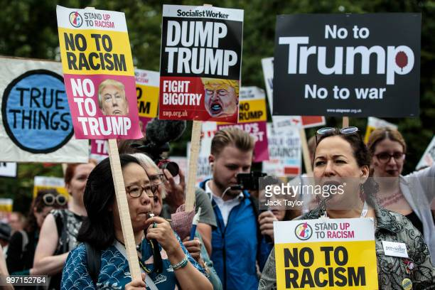Protesters chant and wave placards during a demonstration outside Winfield House the London residence of US ambassador Woody Johnson where US...