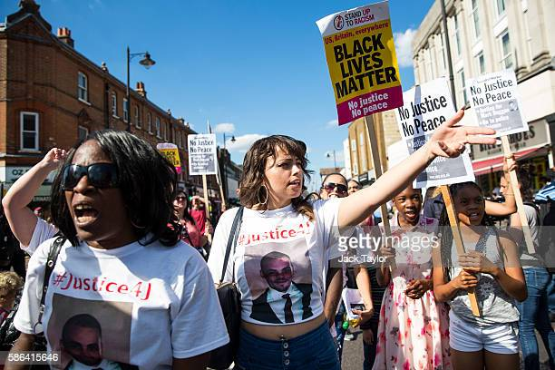 Protesters chant as they march to Tottenham Police Station to mark the fifth anniversary of Mark Duggan's death on August 6 2016 in Tottenham England...