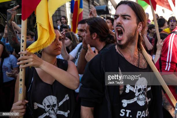 Protesters chant at a group of Spanish National Police during a Catalan proindependence strike of university students on October 26 2017 in Barcelona...