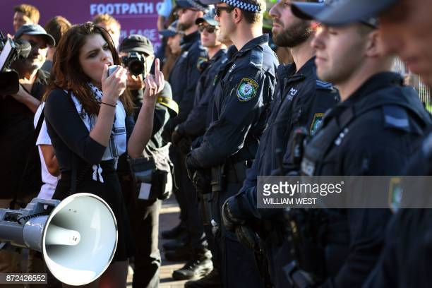 Protesters chant at a Liberal Party fundraiser in Sydney on November 10 as they call on the ruling Liberal coalition government to bring back 600...