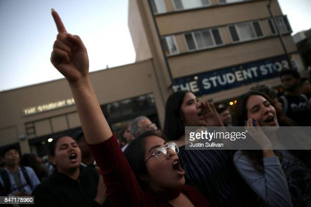 Protesters chant during a demonstration outside of Zellerbach Hall on the UC Berkeley campus on September 14 2017 in Berkeley California Police are...