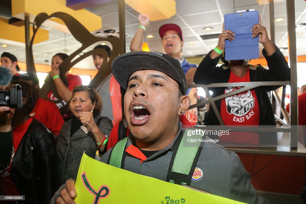 Protesters chant during a take over of a Taco Bell as part of a demonstration for higher wages and better security for fast food workers on December 4, 2014 in Oakland, California. The Taco Bell has been the victim of numerous violent robberies but has no security guard. The protest was part of a nationwide day of demonstrations for higher wages and the right to unionize.