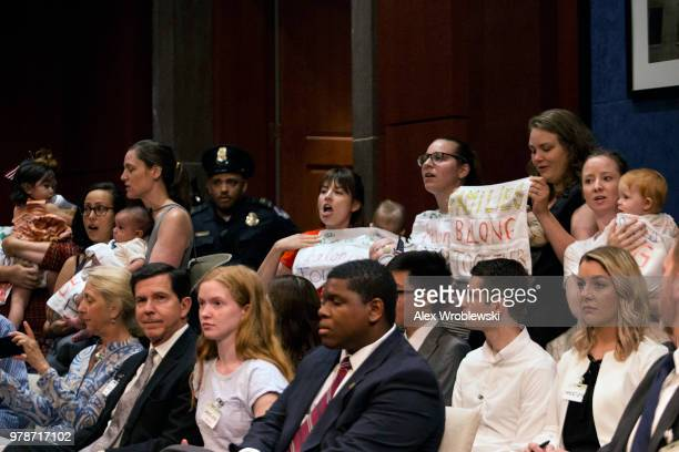 Protesters chant 'families belong together' at a hearing with Inspector General Michael Horowitz on June 19 2018 in Washington DC The Inspector...