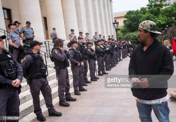 Protesters chant for Ohio State troopers and Columbus Police to take a knee with them in solidarity on the Ohio Statehouse steps on June 1, 2020 in...