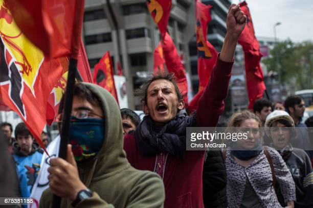 Protesters chant slogans and block a street during a May Day demonstration on May 1 2017 in Istanbul Turkey Small sporadic protests occurred in...