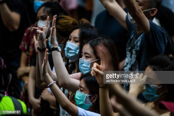 Protesters chant slogans and gesture during a rally against a new national security law in Hong Kong on July 1 on the 23rd anniversary of the city's...