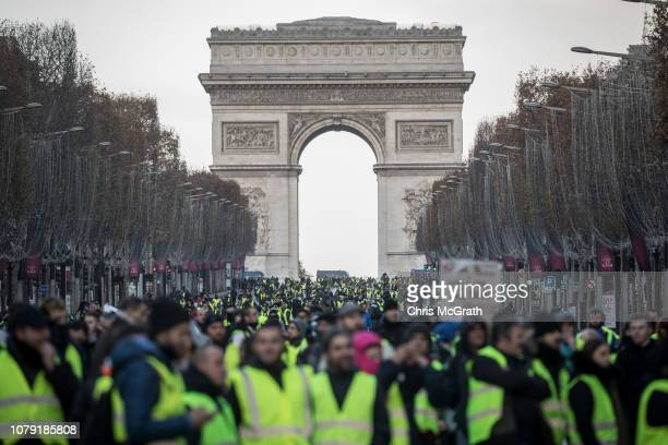 Protesters chant slogans as during the 'yellow vests' demonstration on the ChampsElysées near the Arc de Triomphe on December 8 2018 in Paris France...